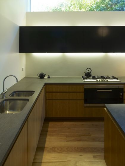 Hird Behan House kitchen joinery detail at night