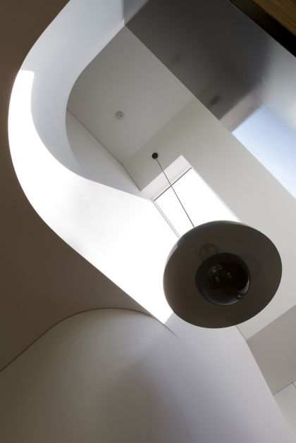 Unfurled House interior view up stair void