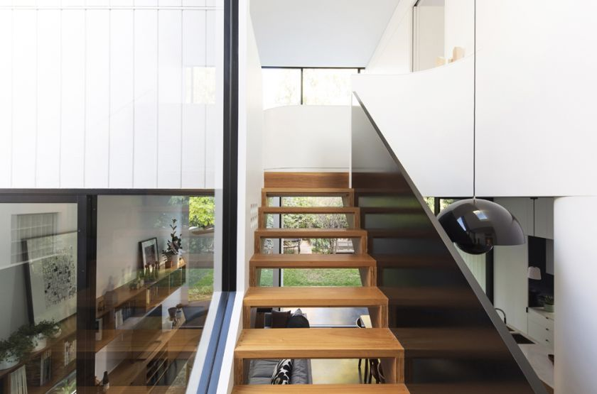 Unfurled House interior detail view of stair to living and first floor spaces beyond