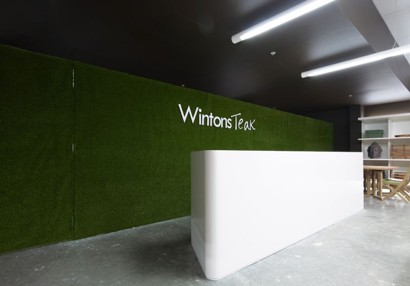 Wintons Teak Showroom sales counter joinery & operable turf wall