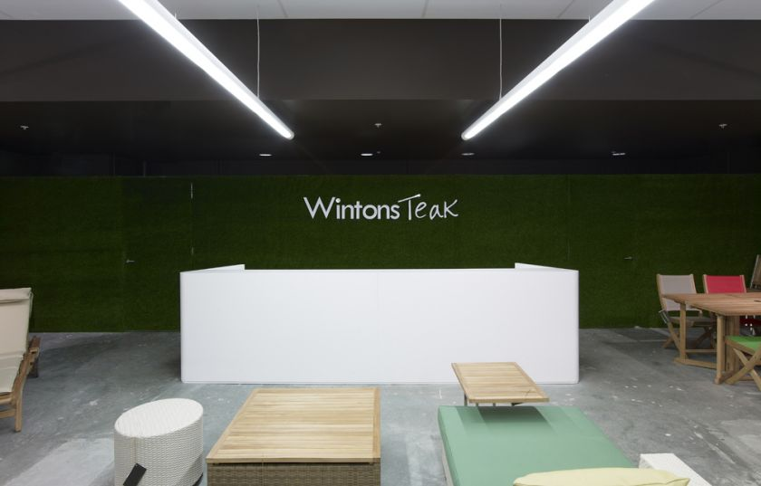 Wintons Teak Showroom sales counter joinery & turf wall