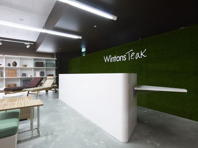 Wintons Teak Showroom sales counter joinery & turf wall detail